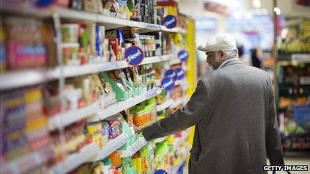 A man browsing shelves in Tesco