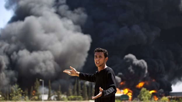 A Palestinian outside Gaza's only power plant in southern Gaza strip 29 July 2014