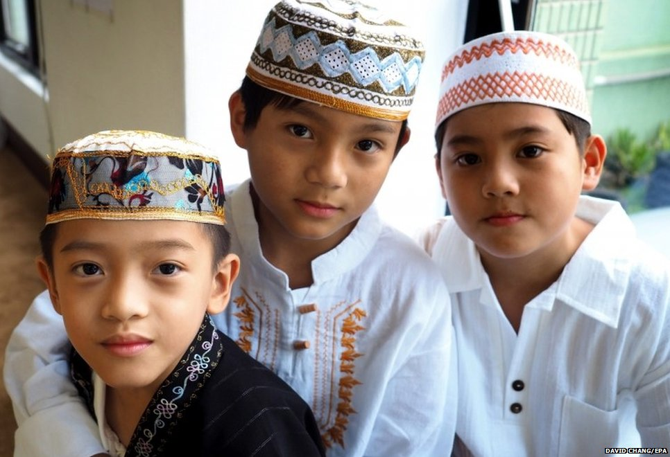 Taiwanese Muslim boys celebrate Eid-al-Fitr at the Taichung Mosque in Taichung City, western Taiwan, 29 July 2014