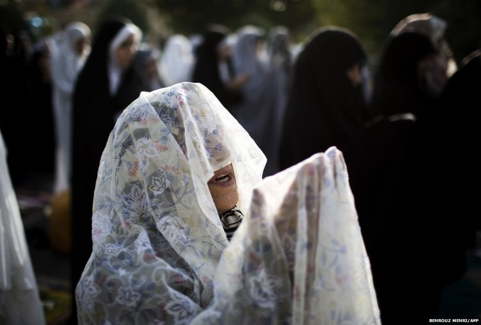 An Iranian Muslim woman performs her Eid al-Fitr prayers in western Tehran on July 29, 2014