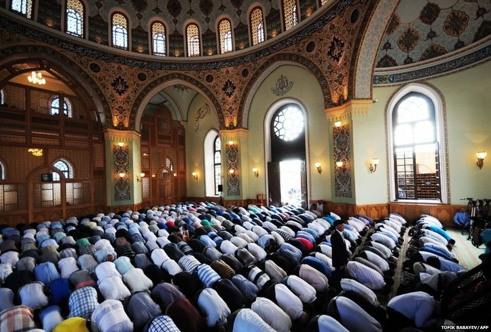 "Azerbaijani Muslims pray in Taza Pir Mosque in the Azerbaijan""s capital Baku, on July 29, 2014"