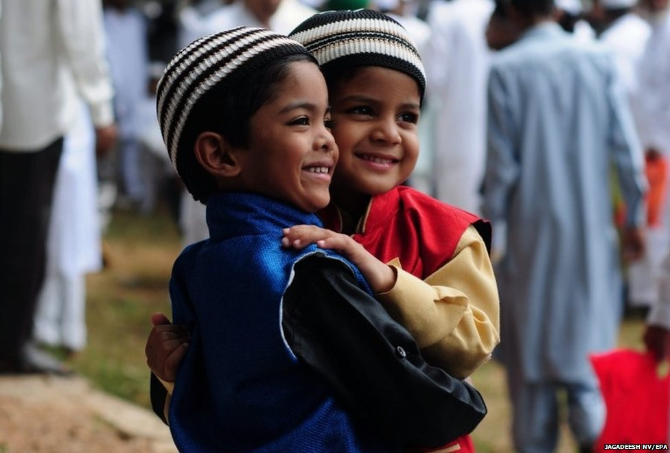Indian Muslims boys hug each other after attend the Eid al-Fitr morning prayers at a masjid (mosque) in Bangalore, India, 29 July 2014