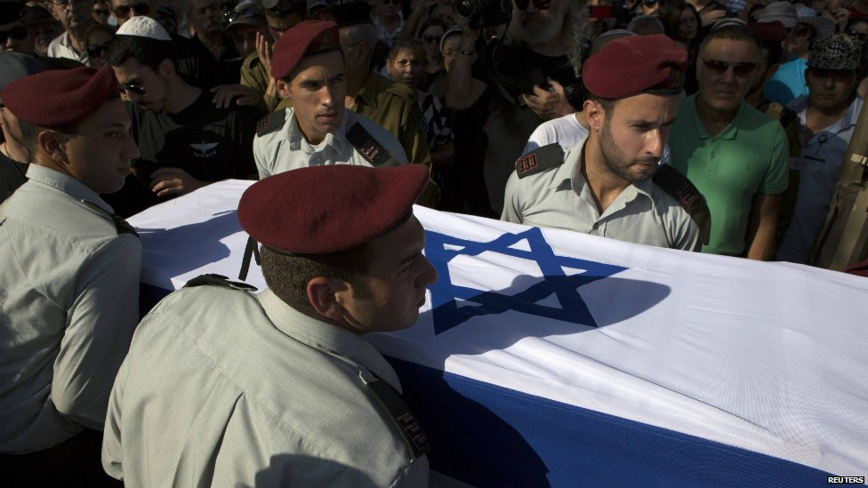 Israeli soldiers carry the coffin of their comrade Liad Lavi, who died after succumbing to wounds he sustained last week while fighting in Gaza - 28 July 2014