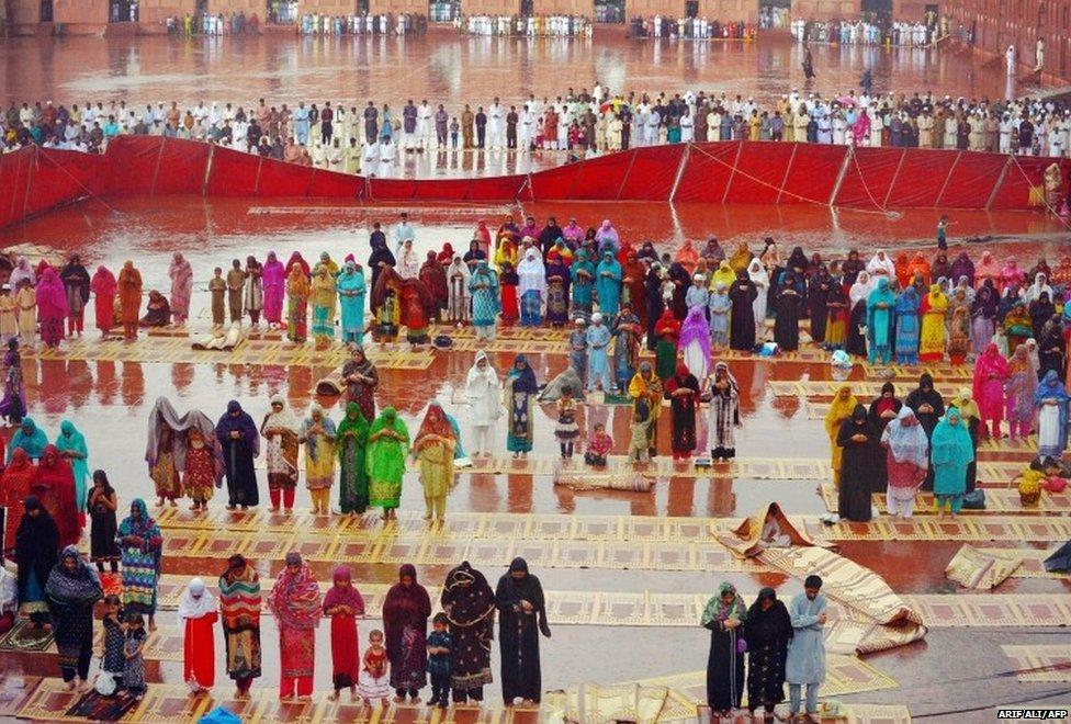 Pakistani Muslim devotees offer Eid prayers on the first day of the Eid al-Fitr festival at Badshahi Masjid in Lahore on July 29, 2014