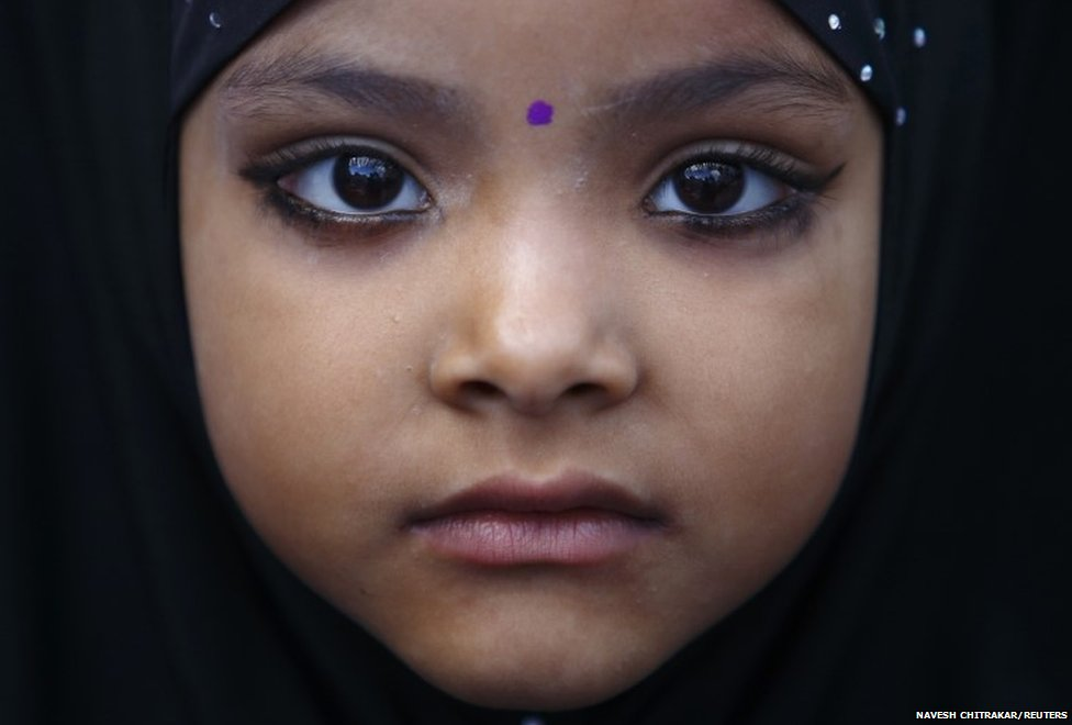 A Muslim girl is pictured as she arrives for the mass prayer during Eid al-Fitr celebrations at a mosque in Kathmandu July 29, 2014.