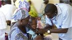 Children being examined by doctors
