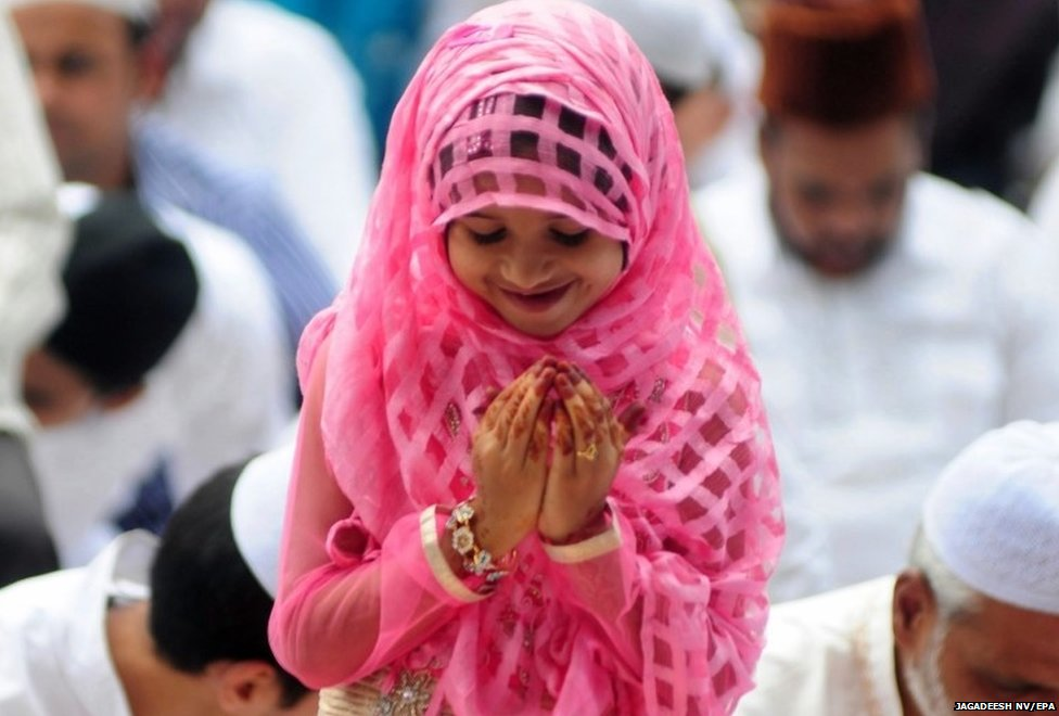 Indian Muslims girl attend the Eid al-Fitr morning prayers at a masjid (mosque) in Bangalore, India,