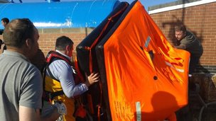 Life-raft being brought ashore at Hartlepool Fish Quay