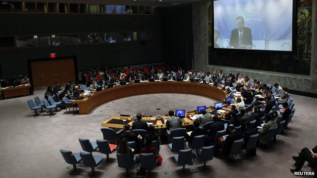 Members of the Security Council watch UN Secretary General Ban Ki-Moon on a screen while they attend a meeting about the situation in the Middle East, including Palestine, at United Nations headquarters in New York, July 22