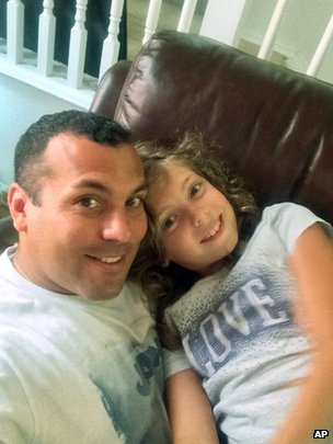 Photo from the family shows Ommy Irizarry and his nine-year-old daughter Oceana Irizarry of Fort Stewart, Georgia 20 July 2014