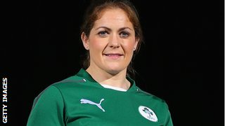 Ireland captain Fiona Coghlan poses with the Six Nations trophy at the launch of the 2014 tournament