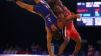 Amit Kumar of India in action against Welson of Nigeria