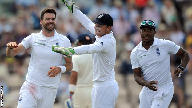England's James Anderson (left) celebrates a wicket