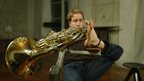 Felix playing French horn