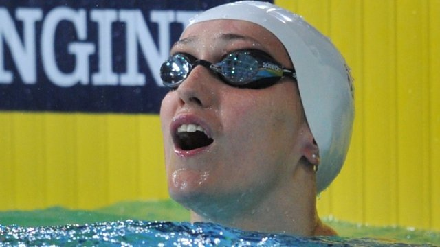 Wales' Georgia Davies takes gold in the 50m backstroke