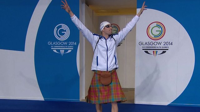 Scotland's Daniel Wallace arrives poolside wearing a kilt