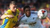Swansea City's Jefferson Montero battles for the ball against Exeter City