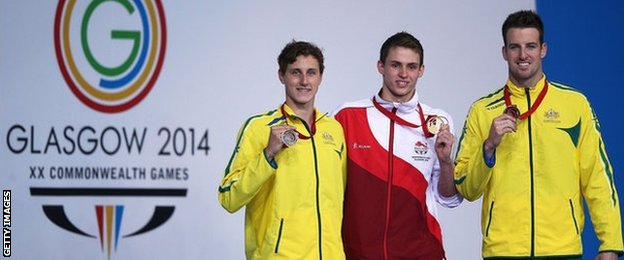 England's Ben Proud after winning gold, with Australians Cameron McEvoy, 20, and James Magnussen, 23