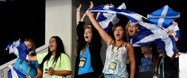 Scotland fans cheer on the country's men's gymnastics team
