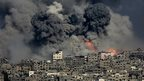 Smoke rises from the Tufah neighbourhood of Gaza City, 29 July 2014