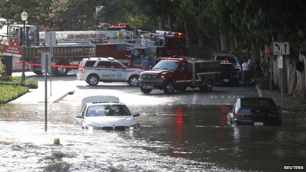 Cars on flooded street near UCLA, Westwood