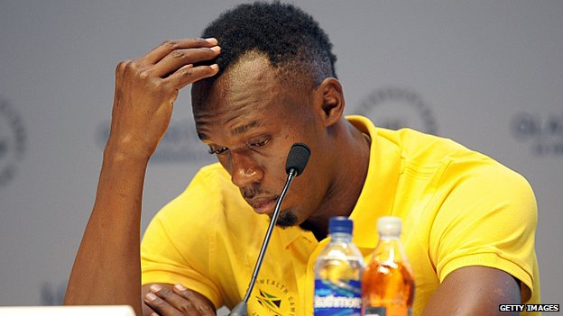 Usain Bolt looking glum at a press conference