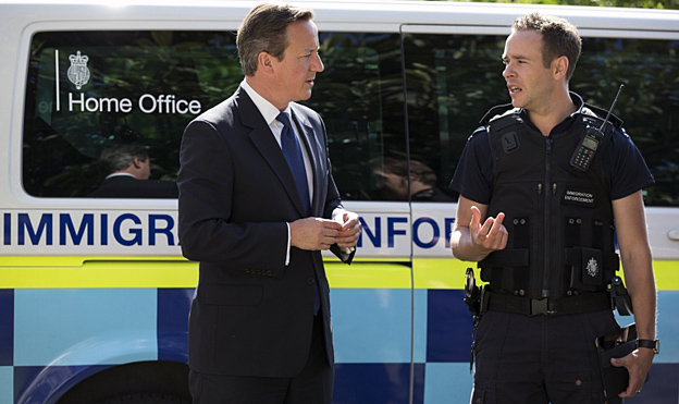 David Cameron speaks to Paul Wylie, director for London and South region of Home Office Immigration Enforcement
