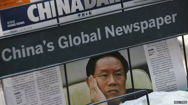 A newspaper with a picture of China's then Politburo Standing Committee Member Zhou Yongkang is seen at a newsstand in Hong Kong on 30 July 2014