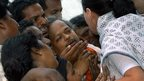 Congress party president Sonia Gandhi with the grieving parents on 18 July 2004