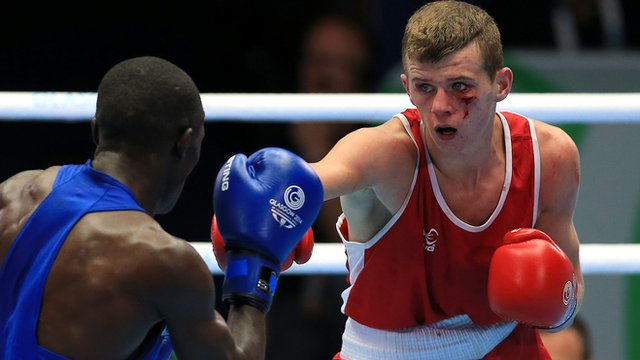 Joe Fitzpatrick throws a punch against Kenyan Nicholas Okongo Okoth