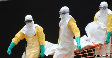 Medics remove body of a victim of the Ebola virus