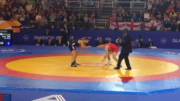 England's George Ramm takes on Scotland's Viorel Etko at the wrestling