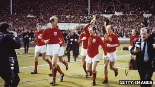 The England team raise the Jules Rimet trophy