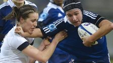 France wing Shanon Izar (right) tries to hold off England full-back Emily Scarratt in this year's Six Nations