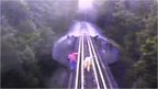 CCTV filmed from the train as it approaches two women on the railway bridge
