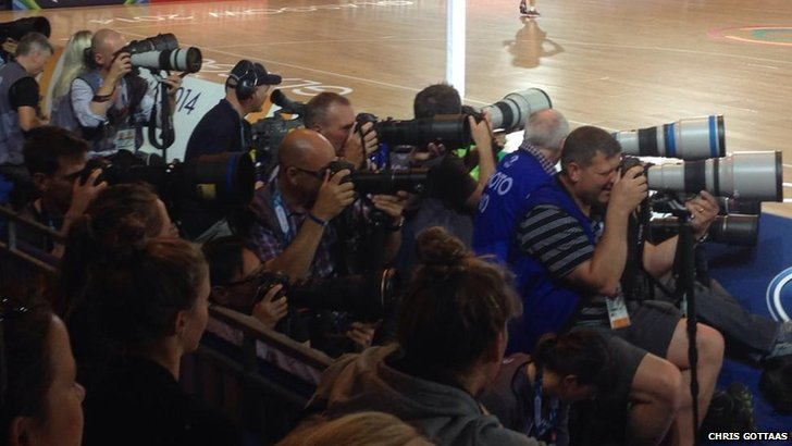 Photographers take pictures of Usain Bolt