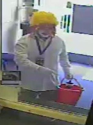 wanted by police over a robbery at a currency exchange in Liverpool