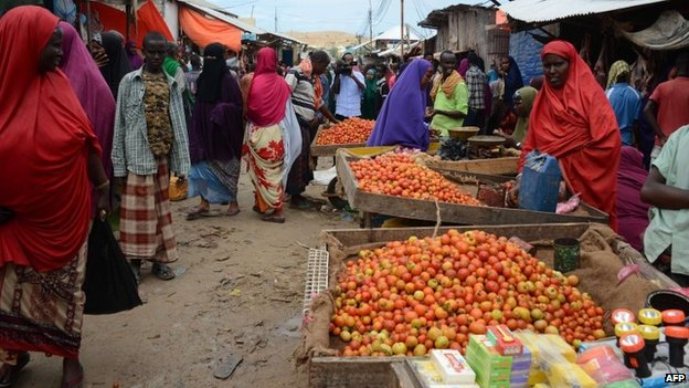 Vendors sell fresh goods at the Karan market, in Somalia's capital of Mogadishu on 30 June 2014