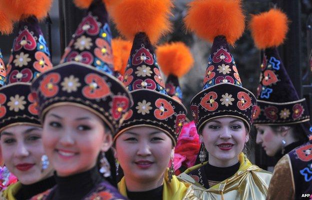 Kyrgyz women in traditional folk dress attend celebrations marking the Central Asian new year, Newruz, in Bishkek
