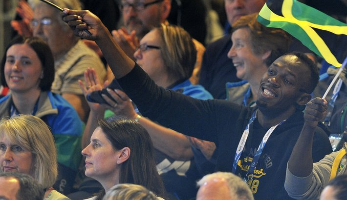 Usain Bolt watching netball at the Commonwealth Games