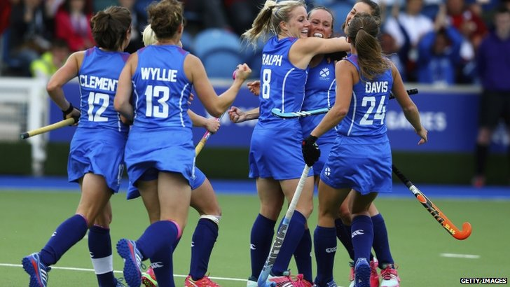 "Nikki Kidd of Scotland celebrates with teammates after scoring a goal during the Women""s preliminaries match between Scotland and England"