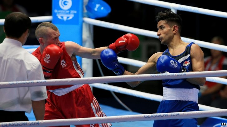 "England""s Qais Ashfaq (blue) in action against Scotland""s Joe Ham in the Men""s Bantam (56kg) Quarter-final"