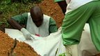 Ebola victim is laid to rest in Guinea