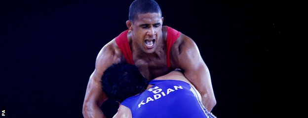 England's Leon Rattigan (red) and India's Satywart Kadian in the 97kg semi-final