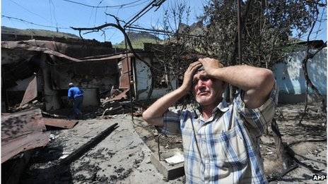 Ethnic Uzbek next to the wreckage of his home following deadly gun battles in southern Kyrgyz city of Osh, June 2010