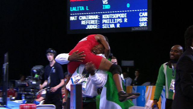 Nigerian wrestler Odunayo Adekuoroye celebrates winning gold at the 2014 Commonwealth Games in Glasgow