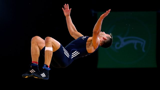 Scotland's Viorel Etko does a back flip at the 2014 Commonwealth Games in Glasgow