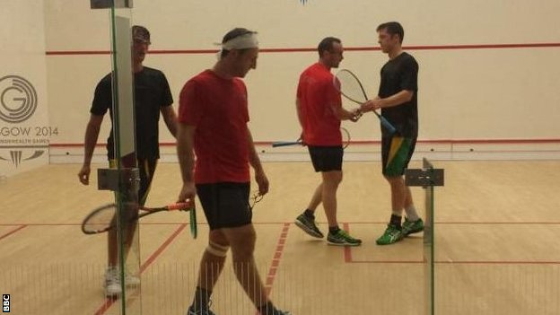 Nick Taylor and Scott Gautier (red shirts) after their loss to Jamaica