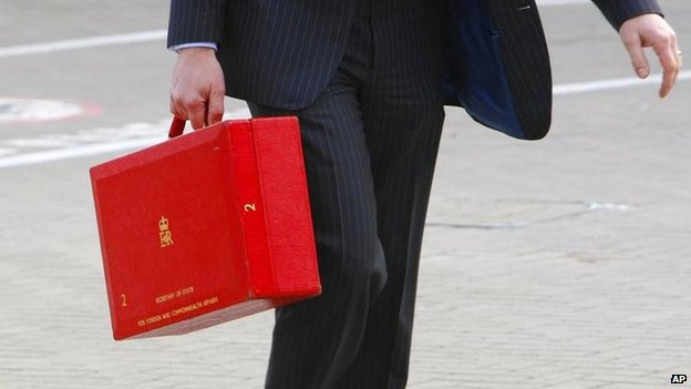 Former foreign secretary David Miliband carrying his ministerial red box in 2009