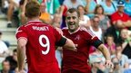 Aberdeen pair Adam Rooney and Nial McGinn celebrate a goal against Groningen